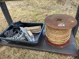 ROLL OF ROPE AND TRAY OF PIPE AND CONCRETE TROWELS