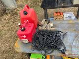 (2) GAS CANS, (2) RATCHET STRAPS AND NET