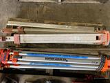 2 TRIPODS AND 2 GRADE STAKES