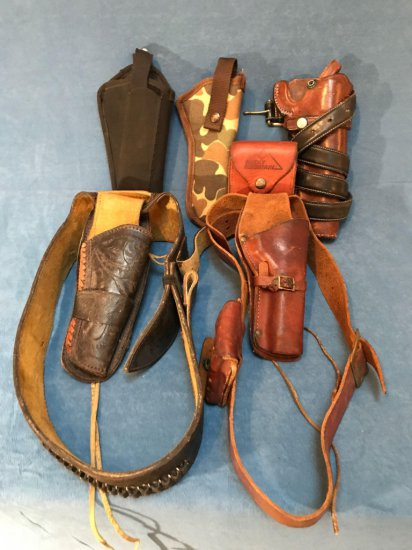 Tooled leather belt/holster and (5) miscellaneous holsters
