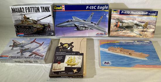 Model kits: (2) Revell planes, (2) Monogram tank & wood aircraft carrier, pirate ship