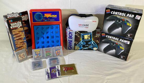 1989 Nintendo Game Boy video game system , MadCatz control pads, RK 5th VR glasses case & games