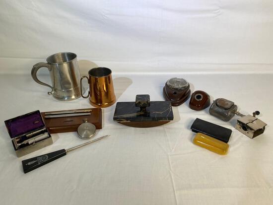 Marble ink blotter, vintage pencil sharpeners and shaving kits