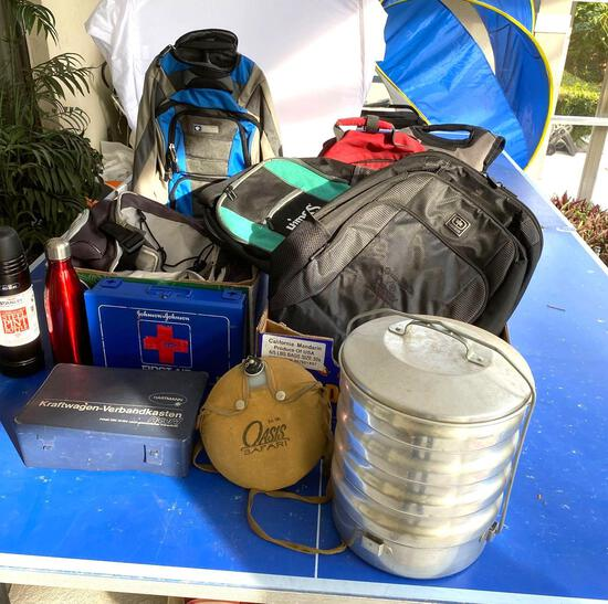 Backpacks, Oasis canteen, stacked camping set, first aid kits
