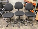 (3) Upholstered black drafting stools