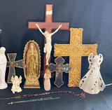 Statue of Mary, crucifixes and angel figurines