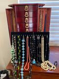 9-drawer jewelry chest and necklaces