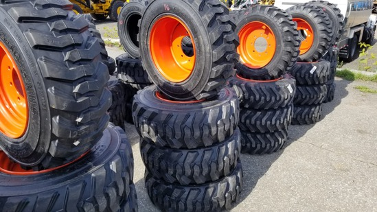 (4) Loadmax 12-16.5 Skidsteer Tires and rims