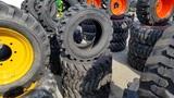 (4) Tuebo 10-16.5 Skidsteer Tires