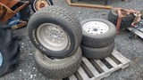 (4) 235/70/15 tires and rims