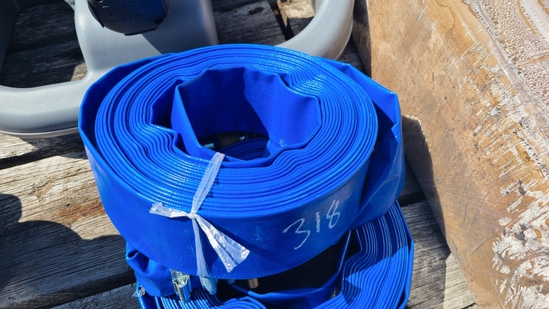 "New 2"" x 50 ft. discharge water hose"
