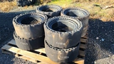 (8) cusioned skidsteer tires and rims