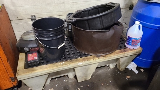 Spill containment with catch pans