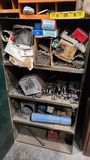 Cabinet with welding rods, clamps. Punches,