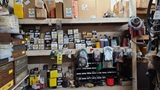 Wall contents - filters, fittings, mower parts
