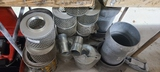 Discharge filters and pipe fittings