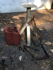 Box Lot/Old Fuel Can, Old Plow, Metal Stand (Local Pick Up Only)