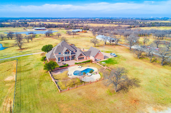 Tract 1: Executive Home w/heated pool, 11 stall show barn & pond on 15 acres