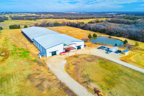 Tract2: 125' x 250' Indoor Arena, 44 stalls, 4 apartments ALL UNDER ONE ROOF on 13.4 acres