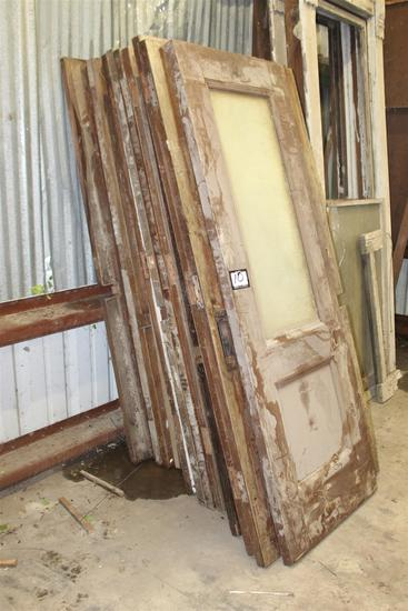 Lot of (19) vintage solid composite doors with oak veneer salvaged from downtown New Orleans bank, a