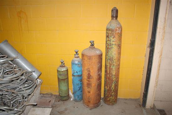 """Salvaged helium containters (lot of 4) ranging in height from approx. 29"""" - 61"""" tall"""