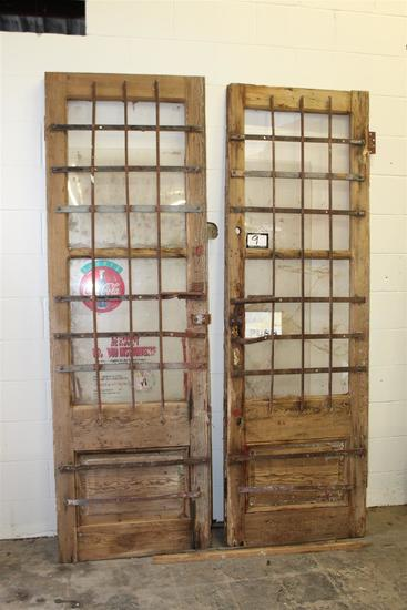 """Set of New Orleans antique storefront doors with iron; approximately 1 3/4"""" x 29"""" x 88"""" each"""