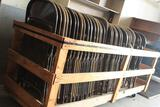 One lot of metal folding chairs w/ wooden rolling chair rack