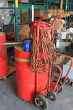 Drum dolly w/ 55 gal drum with pump and screw in funnel - contains Rotella 10W