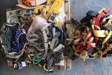 Pallet of misc chains, lifting straps, tie downs, rigging, straps, pallet clamps, cargo nets,