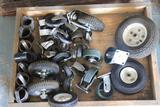 Lot of casters, wheels, includes wooden cart w/rollers