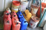 Lot of fuel cans (located behind building)