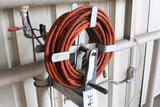 HOSE REEL W/HOSE (BUYER RESPONSIBLE FOR REMOVAL/LOAD OUT)
