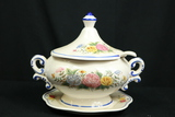 Porcelain Pot with Ladle on Plate