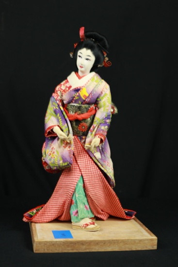 Oriental Doll On Stand