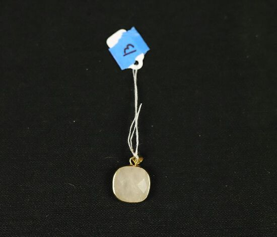 Sterling Silver Pendant With Cut White Quarts