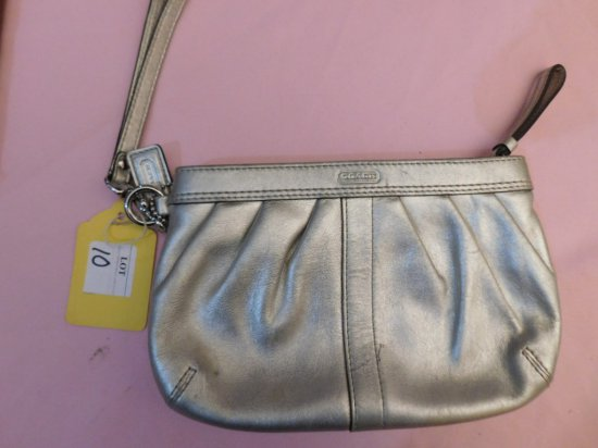 COACH, CLUTCH, SILVER IN COLOR, (2) SMALL PEN MARKS ON THE OUTSIDE