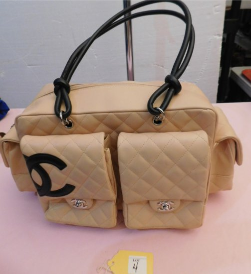 CHANEL HANDBAG, (NEW) TAN  WITH  BLACK INTERIOR,  WITH 4 POCKETS ON THE OUT