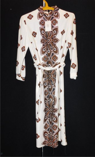 DRESS:  LORD & TAYLOR, SIZE 8, BROWN & WHITE FLOWER DESIGN ON FRONT, HEM IS