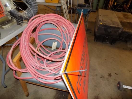 Construction Sign, Air Hose & Blue Chair