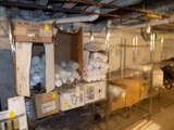 ''To Go'' Containers on 2 Wire Shelves in Basement