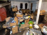 Group Misc Stuff Piled Near Fuel Tank on Right Half of Basement - Plastic D