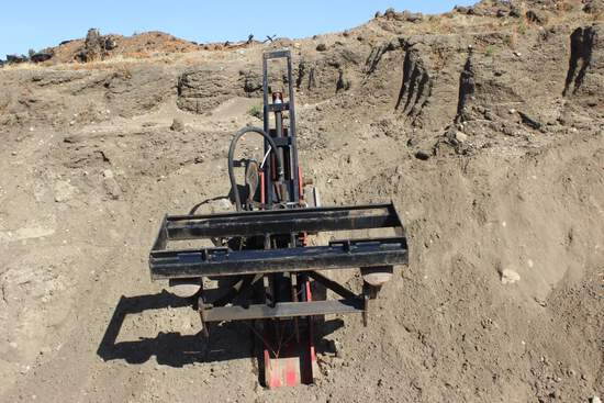 Work Saver post pounder converted to skidsteer attachment