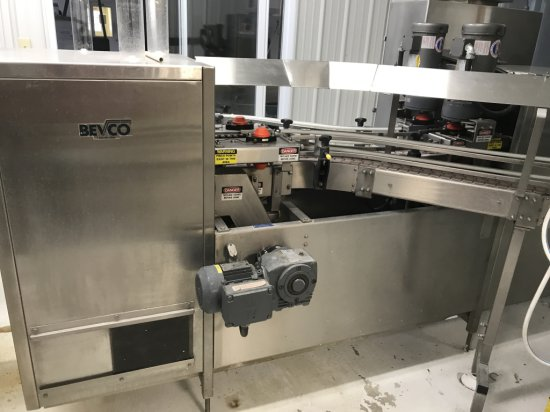 CROWN MODEL #60-12 60 HEAD BOTTLE FILLER W/14' OUTFEED AND 20' INFEED W/45 DEGREE TURN AND ZALKIN MO