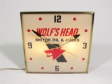 1960S WOLFS HEAD MOTOR OIL LIGHT-UP GARAGE CLOCK