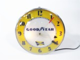 1950S GOODYEAR TIRES GLASS-FACED LIGHT-UP STATION CLOCK.