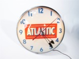 LATE 1950S ATLANTIC OIL LIGHT-UP SERVICE STATION CLOCK