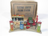 MID-1930S LOUIS MARX ELECTRIC LIGHTED FILLING STATION MODEL