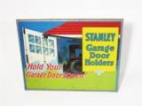 1925 STANLEY GARAGE DOOR HOLDERS TIN GARAGE SIGN