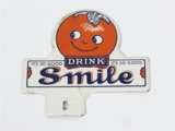 1930S SMILE ORANGE SODA TIN LICENSE PLATE ATTACHMENT SIGN