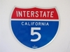 "ADDENDUM ITEM - VERY NICE CALIFORNIA INTERSTATE 5 DIE-CUT SHIELD SHAPED HIGHWAY SIGN. SIZE: 24""X24"""
